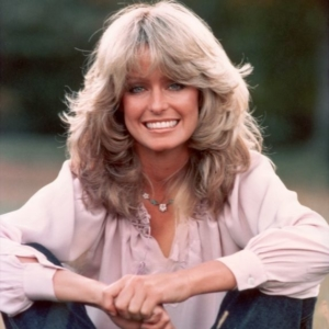 "Farrah Fawcett mit der 70er Frisur ""feather cut""."